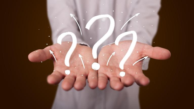 Male hands with question marks | dentist in fayetteville