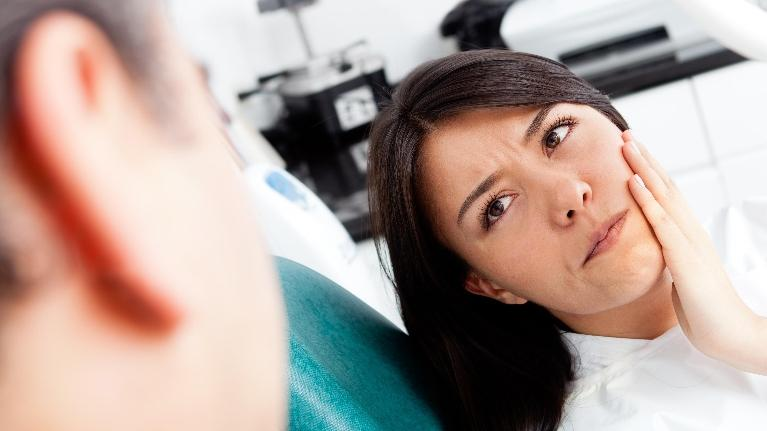 Woman In Pain | Scott J Stephens, DDS